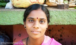Portrait of a young Indian lady selling vegetable at Devaraja open market in Mysore, Karnataka (India)