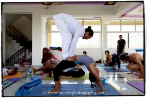 Yogi Kamal Singh doing asana adjustments Tattva Yogashala Rishikesh